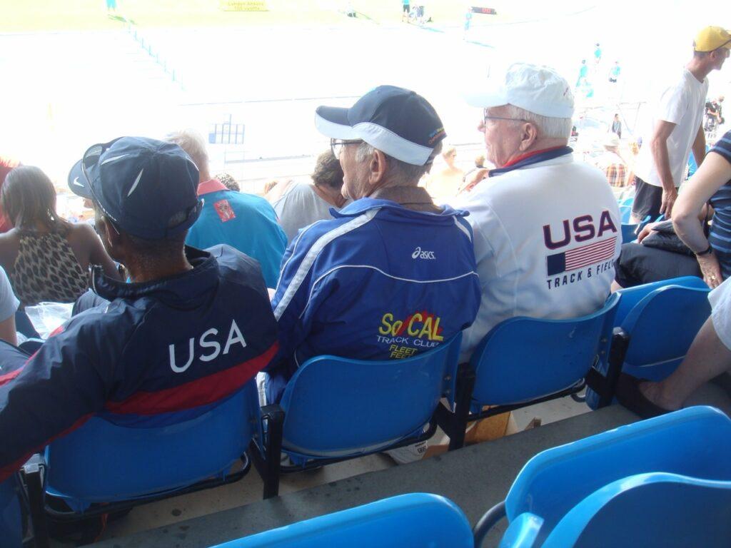 three men wearing USATF jackets