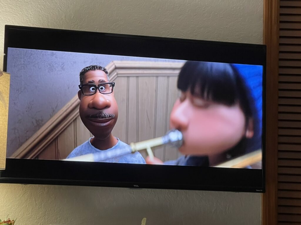 Photo of TV showing a scene from Disney Pixar song
